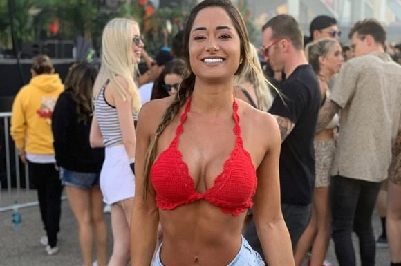 Bruna Luccas posing in red dress and shorts