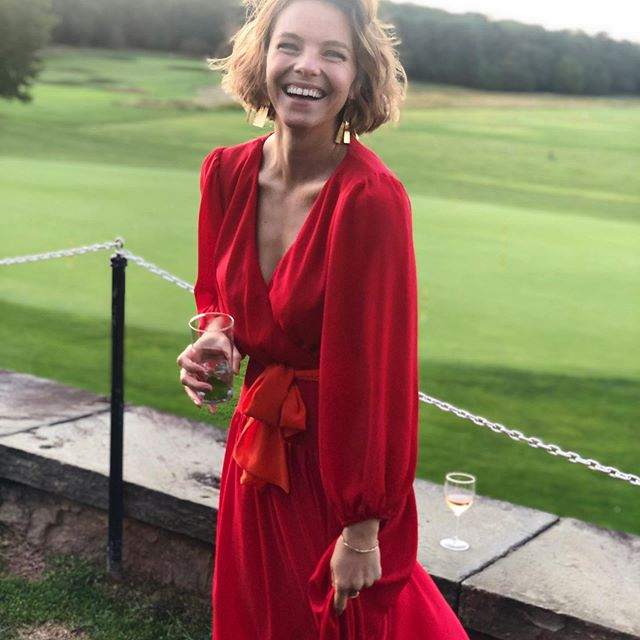 eloise mumford smiling in red dress